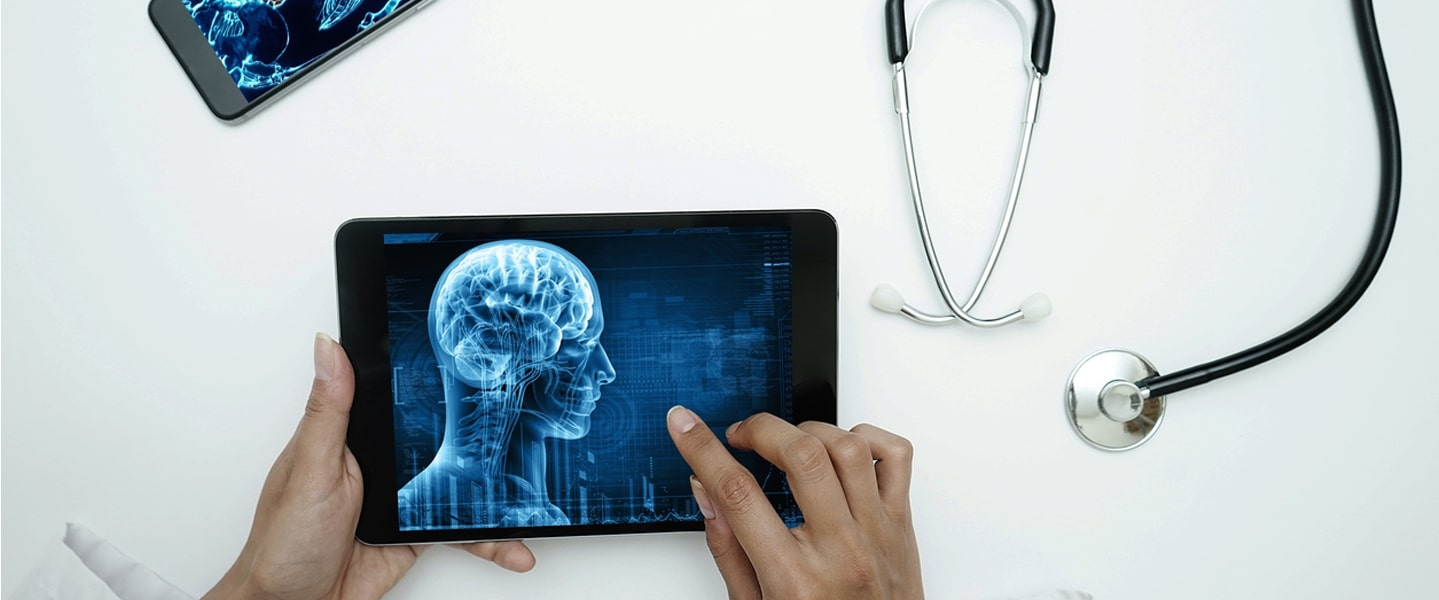 woman looking at digital healthcare consultancy touch screen