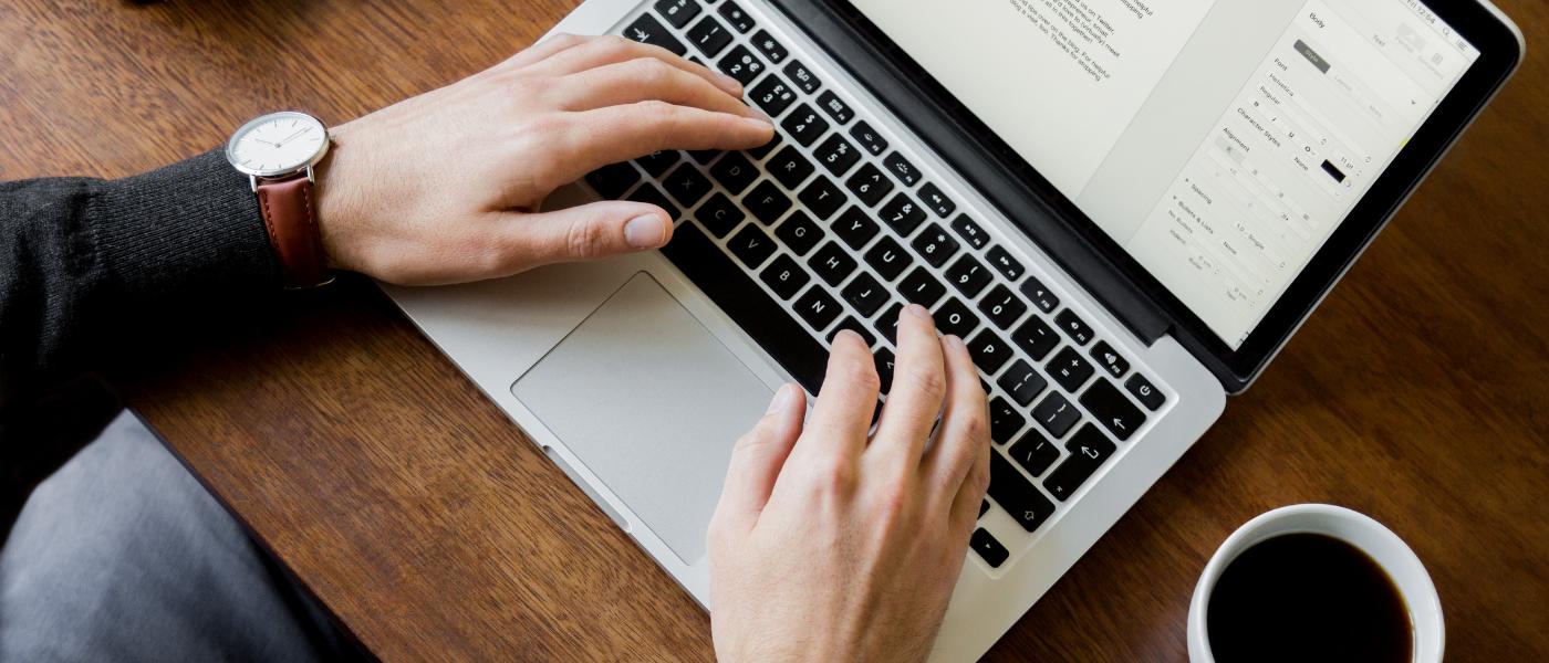 typing on laptop digital marketing testimonials