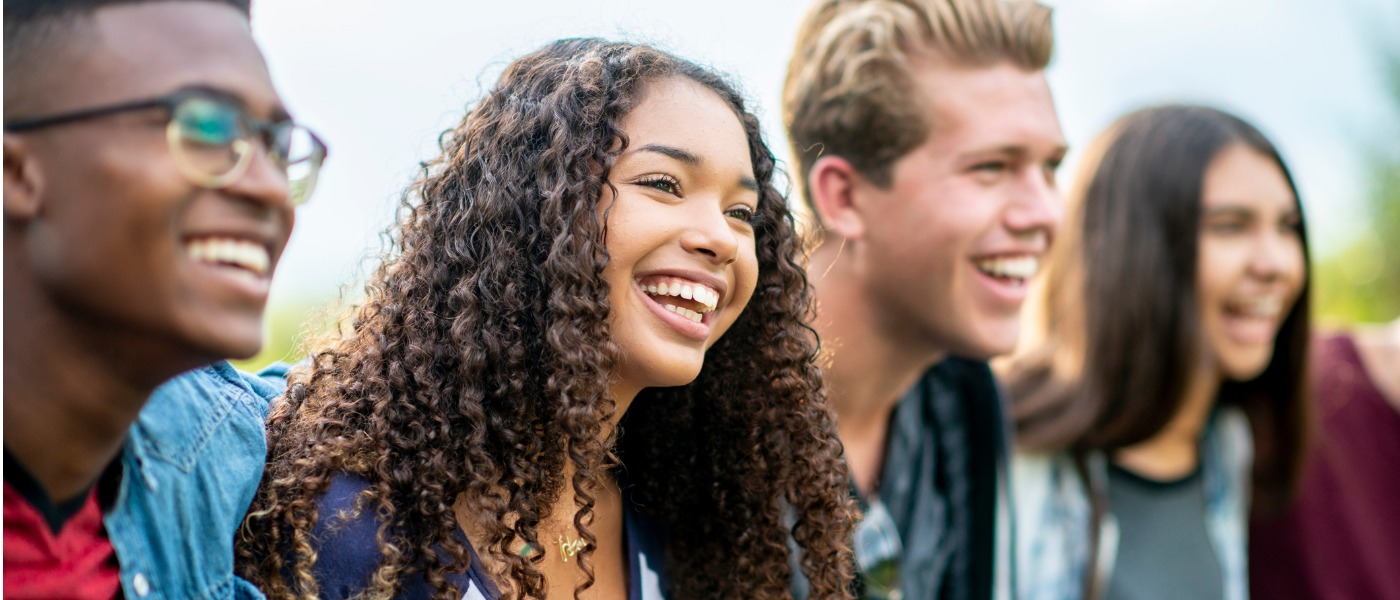 teenage-friends-laughing-outside-picture-id1037044238
